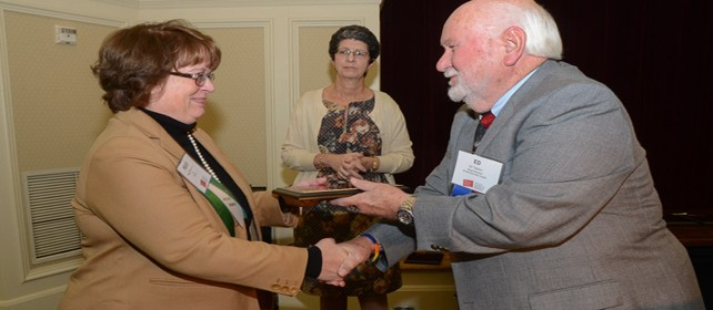 Monarch accepts N.C. Council 2014 Excellence Award