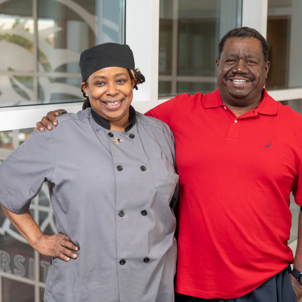 Burnell Gilliam, left, and Gary Bowen, right, in a red shirt, pose at Winston-Salem State University.