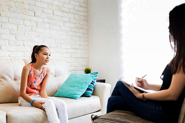 Young girl receiving mental health counseling