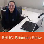 Behavioral Health Urgent Care's Brianna Snow at her front desk post.