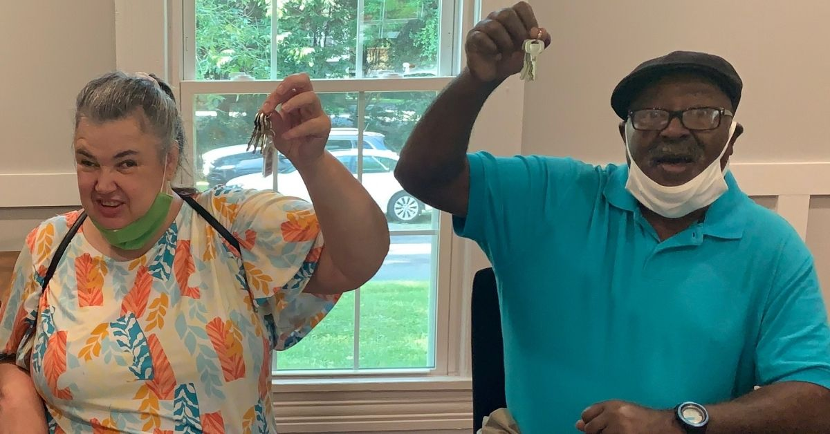 Beverly and Jimmy Colson hold up high the keys to their new Habitat for Humanity home on closing day.