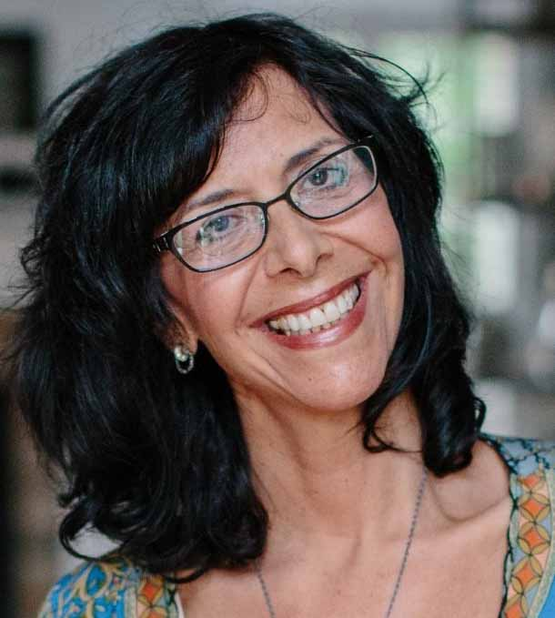 Photo of Behavioral Health Therapist Michelle Chachkes, dark hair and dark rimmbed glasses.