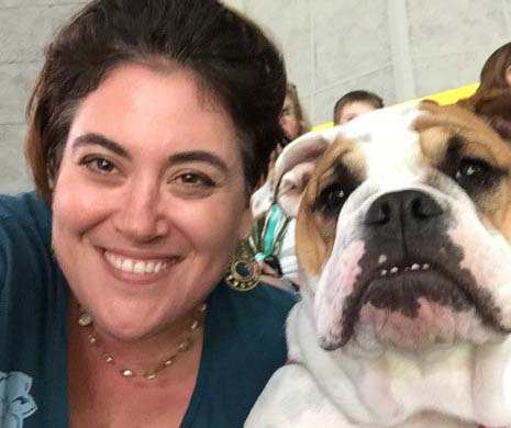 Monarch Board Member Kara Guerriero poses with her English Bulldog, Emma.