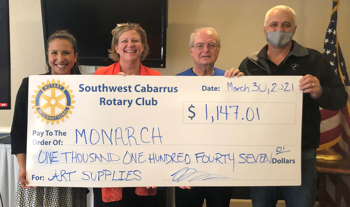 Monarch staff receive donation from Rotary Club of Southwest Cabarrus