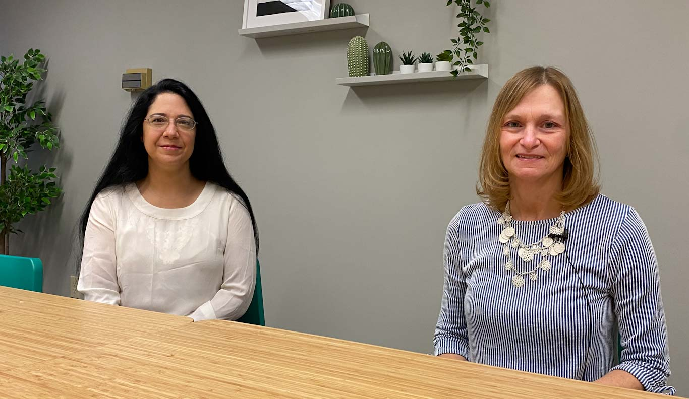 Sandy DeOliveira and Gayle Van Horn in Mecklenburg Behavioral Outpatient group therapy room