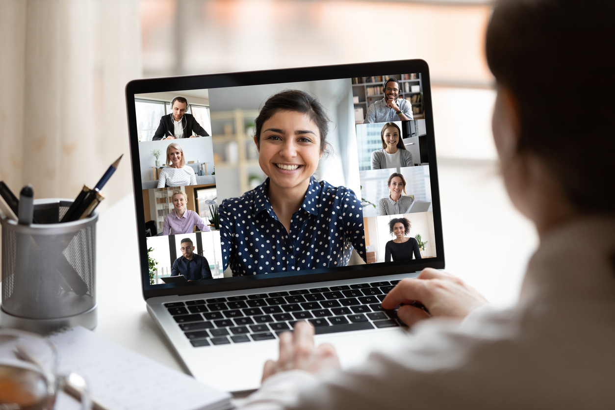 Person in the right corner viewing others on a group call on a laptop.
